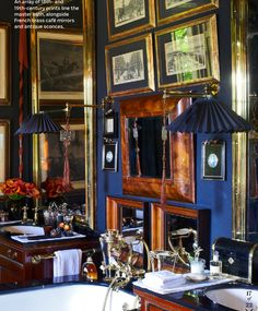 Anouska Hempel ~ array of 18th-19th c prints, French cafe mirrors and sconces line wall of bath