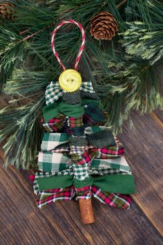 Fabric Ideas Scrap Fabricfabric Christmas tree Tree Ornaments - Just in time for Christmas, learn how to make Scrap Fabric Tree Ornaments from fabric remnants, cinnamon sticks, and buttons. Stick Christmas Tree, Rustic Christmas Ornaments, Fabric Christmas Trees, Christmas Crafts For Kids, Homemade Christmas, Christmas Tree Decorations, Holiday Crafts, Christmas Diy, Ornaments Ideas