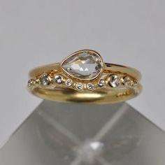 White pear rose cut  sapphire engagement & wedding ring set -  18k gold. $1,975.00, via Etsy.