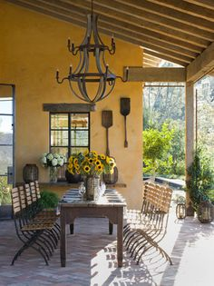 Outdoor dining rooms are a great option in Southern California! Try wrought iron pieces, like this chandelier, for a rustic touch.