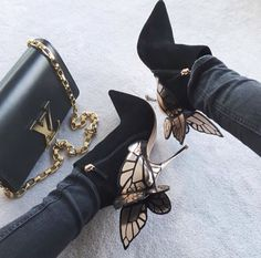 ..ok these shoes are pretty cool..black and gold butterfly heels..