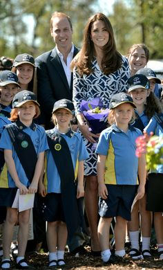 The Duke and Duchess of Cambridge pose with Winmalee Girl Guides after planting a Summer Red Eucalyptus tree at Winmalee Guide Hall in Yellow Rock during the eleventh day of their official tour to New Zealand and Australia on April 17, 2014 in Winmalee, Australia.