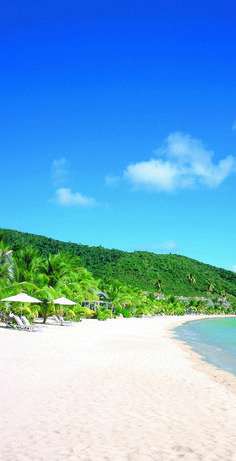 Travel to Carlisle Bay to enjoy your own private beach and pristine waters on the idyllic Caribbean island of Antigua. Experience massages and body treatments in the award-winning Blue Spa.