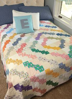 DOUBLE BOW TIE by Bev Getschel: Designer Bev Getschel was inspired to design this bed-size quilt pattern when a similar looking antique coverlet was found among her favorite aunt's treasures. Although the original maker is unknown, Bev has always hoped that it was her grandmother who made it. Make this quilt your own by giving it a modern appearance with a suitable choice of fabrics. Or, keep it vintage by following Bev's lead. The choice is yours!