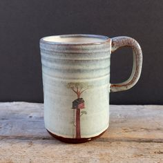 Man-size handmade mug with light blue and cream glaze and hand painted treehouse print. Great for a BIG tea or indulgent hot chocolate.  It