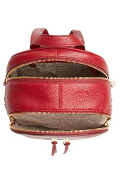Free shipping and returns on MICHAEL Michael Kors 'Extra Small Rhea Zip' Leather Backpack at Nordstrom.com. Gleaming exposed zippers illuminate the compact silhouette of a street-savvy shoulder bag cut from color-saturated leather. Raised goldtone logo letters serve as a signature signoff.