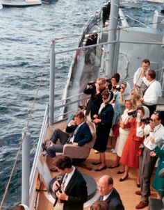President and Mrs. Kennedy watch the first America's Cup race from the deck of a boat, September 15, 1962.