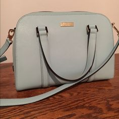 """Kate Spade Newbury Lane Small Felix This purse is gorgeous. I'm reposhing because it just doesn't fit with my lifestyle, too fancy for this mommy of two boys.  it was NWT and I wore it once to a work function. It's in perfect condition, no blemishes.     -14-karat light gold plated hardware. satchel with optional cross body strap and zip top closure. -interior zip and double slide pockets. -8.4""""h x 10.3""""w x 4.5""""d. drop length: 4.5"""". total strap length: 47.2"""". No trades please. I'll Accept…"""