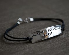 Crossfit Stamped Bracelet - Customized Sterling Silver and Leather. $26.00, via Etsy.