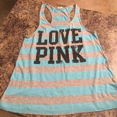 PINK Victoria's Secret racerback tank. Size XS. This is a blue and grey striped tank from Victoria's Secret! Size XS! With LOVE PINK written on the front in black. Very cute. Only worn a few times to workout. Too small for me now! Victoria's Secret Tops Tank Tops