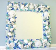 """The Seaglass ~~ Starfish Mirror combines white seashells, a variety of blue and green hand-selected pieces of sea glass, sand dollars, pearls, and white starfish and is shown in """"Bright Mixed"""". Seashell Crafts, Beach Crafts, Diy And Crafts, Coastal Mirrors, Coastal Decor, Decorative Mirrors, Shell Mirrors, Coastal Living, Starfish Mirror"""
