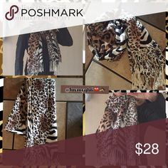 🆕Italian Designed Animal Print Fringe Scarf A Stunning Italian Designed Fringe Scarf with a Beautiful Wild Animal PrintDesign, Perfect for adding a Glamorous look to your outfit this Autumn and Winter. Light, Full, Nice size scarf,68 inches long with 4 (+1/2 inch Fringe on each end), 25 inches wide. Boutique purchase! Boutique Accessories Scarves & Wraps