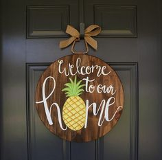 "This bright and cheerful pineapple door hanger is the perfect addition to any front door this summer. This summer door hanger features a pineapple with the quote ""Welcome to our home."" It would make a great mothers day or housewarming gift. This pineapple door hanger would look great"