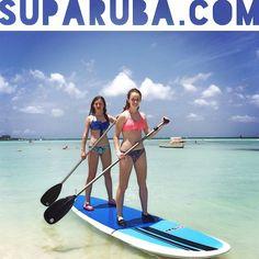 Megan & Alexandra from Pennsylvania tandem paddleboarding at Stand Up Paddle Aruba! www.SUPARUBA.com