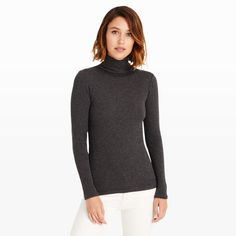 Cut in a sleek silhouette, our ribbed Julie turtleneck is a favorite for a reason. Layer it under a V-neck dress or jumpsuit for a modern play on texture. Cotton/polyester/cashmere Slim fit 26'' in length, based on a size M Turtleneck; vertical rib construction Online exclusive Dry clean Imported