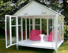 Made from recycled windows. What an awesome outdoor retreat! I must have one!