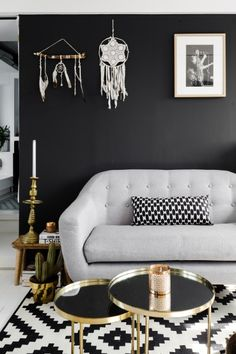 A black wall, gold table, monochrome carpet, statement candlestick and a Peal Grey Ritchie sofa. Dreamy. | made.com/unboxed