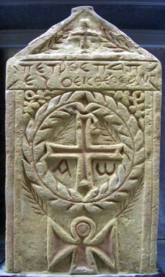 Gabled sandstone stela decorated with a central Chi-Rho and alpha-omega monogram enclosed by a wreath; Greek(?) text beneath the pediment. Culture/periodCoptic term detailsByzantine term details Date5thC-7thC Production placeMade in: Egypt
