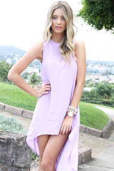 This lilac high low dress looks lovely on this model's skin tone and works well with her blonde hair.