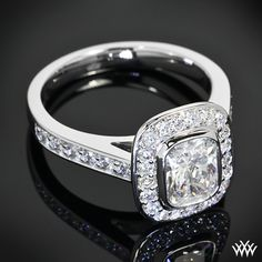 """This """"Isabella"""" Diamond Engagement Ring is set in 18k White Gold and holds 0.26ctw A CUT ABOVE® Hearts and Arrows Diamond Melee. A gorgeous 1.15ct Expert Selection Cushion Cut Diamond is held in place by a delicate full bezel."""