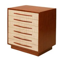 Mike Fisher - Heartwood Creations - 7 Drawer Jewelry Box This beautiful Heartwood Canyon Collection jewelry box is made with Bubinga, Tiger Maple and Bloodwood. Six standard drawers featuring a versat