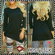 "**HOST PICK**   A-symmetrical long sleeve top. ""Pretty, Girly & Flirty"" HOST PICK. With button detail on front. A-symmetrical hem line.  Crew neck. Long sleeve.  New with tag.  Size is XL, but fits more like a large. Boutique  Tops Tees - Long Sleeve"