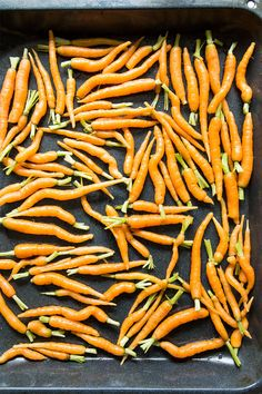Maple Roasted Baby Carrots dressed with Carrot Top Pesto make a delicious sweet and savory side dish that complements any meal. This is a great recipe to have handy during the holiday season.