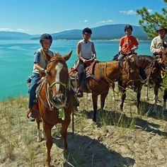 Family horseback riding at Flathead Lake Lodge.  Top50ranches.com - I can personally attest to the fact that if you are looking for a true family vacation and Montana experience, that the Averill family has the BEST place to stay!