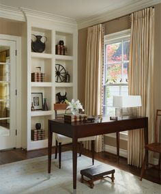 Custom millwork highlights a quiet corner of this living room