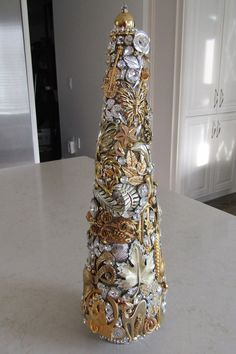 Stunning jeweled Christmas tree. There are approximately 68 vintage brooches/pins, and over 100 rhinestones. Flowers, leaves, bows, butterflies, a ballerina, and cats are just a few things you will see on this tree. Much more beautiful than the pictures show. Measures 15 x 4 1/4. Jeweled Christmas Trees, Cone Christmas Trees, Christmas Tree Design, Office Christmas, Handmade Christmas, Christmas Crafts, Christmas Ideas, Holiday Ideas, Christmas Wreaths