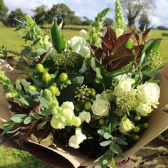 Autumnal, rustic hand tied bouquet in neutral shades