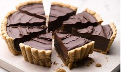 I like my pie how I like my men - deep, dark and carrying chocolate. | pecan crust bourbon chocolate tart