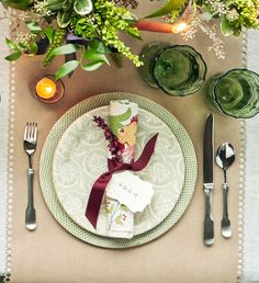 Punch out a delicate border along the edge of a kraft paper runner. Add a not-too-sweet pop of color with a green charger and top it with a complementary patterned plate (terrafirmaceramics.com). Sculptured flatware (matchpewter.com) offsets an unapologetically bold floral napkin (sisterparishdesign.com), which doubles as a place card.  For the Runner: Cut an 18-inch-wide piece of kraft paper to desired runner length, then use an edge puncher (Notched Square Edge Punch, $14; 123stitch.com)…