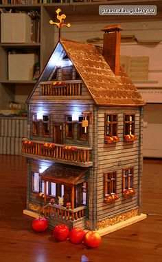the blue wooden dollhouse by miniwood, via Flickr