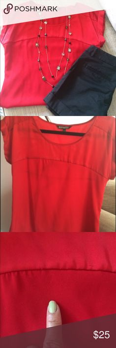 Red Silky EXPRESS Blouse Beautiful and vibrant silky blouse. Upper part by chest  and arm is shiny and the bottom part is a polyester and not shiny. Great condition, a small area of piling which is in the middle right in chest area. Cap sleeves and nice and light and flowy. Express Tops Blouses