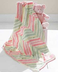 This blanket features chevron patterning in the bright and cheery shades of Bernat Baby Jacquards. Approx 36 x 42 ins [91.5 x 106.5 cm]. Shown in 06230 (Spearmint Candy). 4mm (US 6) knitting needles. 4mm (US 6) circular needle 36 ins [90 cm] long.
