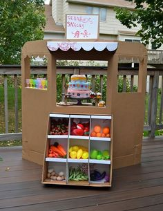 We love this new take on the play kitchen: play green grocer store!  LiEr of Ikat Bag makes amazing things for her kids out of cardboard; remember this faraway tree?  She's just completed an amazing green grocer store, and she provides a great tutorial, too.