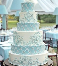 Such a pretty wedding cake for your winter wedding if it were mine however I would lighten the blue and put a sparkly topper, but this is almost flawless!