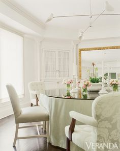 Designer Vincente Wolf's signature mix includes unmatched chairs at the dining table.