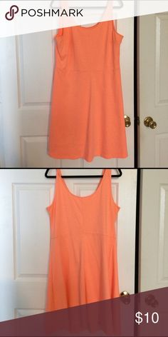 Orange a-line Dress Cute cotton a-line dress.  Very complimentary color- makes you look tan almost year round! Versatile- dress up with a belt and jacket/ sweater or could be used for a pool coverup Old Navy Dresses