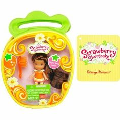 Strawberry Shortcake Hasbro Mini Doll in Purse Orange Blossom Version 3 by Hasbro. $6.90. Includes Doll with rooted hair you can style, removeable outfit, brush & purse.. This tiny friend is very sweet and berry sweet smelling! Brush your pretty little Orange Blossom figures hair to make sure shes just as lovely as can be and then bring her along with you on all kinds of delicious adventures!