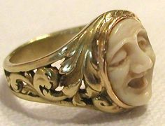 Outstanding Circa 1870, unique French very heavy 18k gold Ring with the center Sculpture carved as a Face resembling one of the 'Masks' of the Theater.