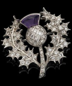 An 18ct gold amethyst and diamond thistle brooch, London 1976 Set throughout with round brilliant-cut diamonds, the flowerhead set with a cabochon-cut amethyst, width 30mm, stamped 'WT & S'