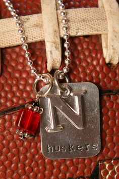 Team Spirit Jewelry!  Glam up your Husker outfits with a Pixie Dots piece.  Chose this one or we can design one especially for you!https://www.facebook.com/mel'spixiedotspage  message me with any questions you might have!