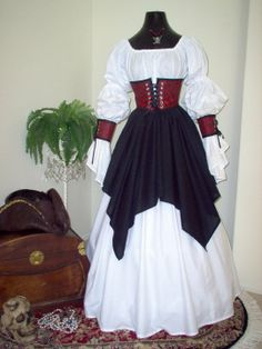 The skirts and shirt is made from 100% cotton. The cincher and cuffs are made from a red and black skull and crossbone brocade fabric. The fabric is available in other colors and different patterns are available. This costume can be made in any size.