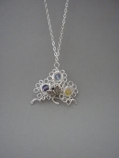 Three Flowers and Butterfly Wirewrapped Pendant.