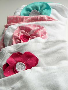 Embellished Onesies - This shows how to create cute little dresses out of inexpensive onesies.