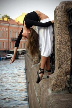 crazy flexibility in her back...over the water!