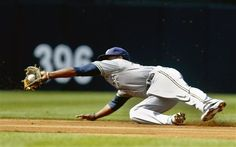 24/162 - Brewers 9, Padres 5 - Brewers second baseman Rickie Weeks makes a diving catch on a line drive hit by San Diego Padres' John Baker during the second inning; Weeks made the catch and then threw to first to get a double play - (May 2)