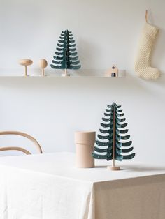 Create a wintery atmosphere in your home with this dark forest green/blue tree, or send it to someone as a gift. It is an A4 flatpack and fits through the letterbox! Construct this 30 cm tall paper fir tree in less than 10 minutes. The light beechwood trunk has holes through which to thread the branches. You don't need to cut anything: All the parts are pre-punched, ribbed and perforated. And of course it also includes metal wire with which to assemble the parts. Dark Forrest, Wood Trunk, Minimalist Christmas, Paper Tree, Magical Forest, Fir Tree, Build Your Own, Branches, A4